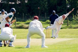 Chris Smith bowling for Oakfield & Rowlands 2nds on Saturday in their first league game of the season