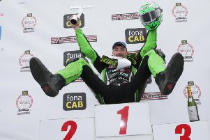 Glenn Irwin celebrates made it four Superbike victories in a row at the North West 200 on Saturday. Picture: Stephen Davison/Pacemaker Press.