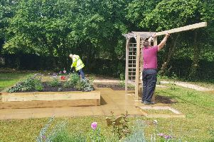 Work taking place at the sensory garden at Heart of England Mencap's day centre in Leamington