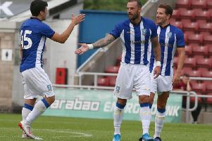 Steven Fletcher celebrates firing Sheffield Wednesday into a 2-0 lead against the Cobblers (Pictures: Pete Norton)