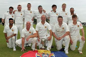 Brigade players celebrate retaining the Bank of Ireland North West Senior Cup.
