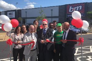 Cllr Kerry (front, second from left), Cllr Bowater (middle) and Stephen Cole (right) at the opening with Grovebury Road Retail Park employees.