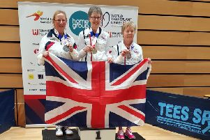 Grace Newman (left) receives her silver medal at the World Transplant Games 2019 in Gateshead.