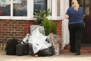 The National Crime Agency officer at a property in Westdean Road, Worthing. Picture: Eddie Mitchell