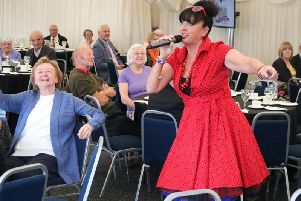 Performer Ruby Ann Sings entertaining Warwick District Council tenants and guests.