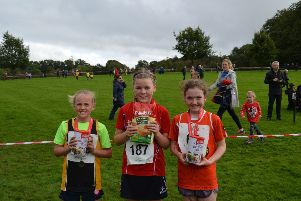 Southern Girls' Race from left are Erin Crummie from St Patricks PS, Crossmaglen (3rd), Emma McEntee from Moira PS (1st) and Annie Rice from Christian Brothers PS (2nd)