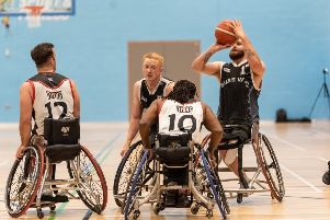 Bears' Macauley Thompson shoots under pressure from London Titans' Ade Adepitan.