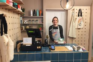 Charlie Demetriou at the counter in her new Zero store in Leamington.