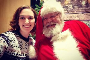 Lucy Field with Father Christmas at a previous 'breakfast with Father Christmas' events. Photo submitted.