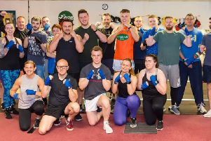 Staff from Tesco Banbridge, Portadown, Lurgan and Craigavon get ready for their Fight Night to raise funds to buy Lexie a trike for Christmas