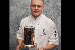 Chef Nathan Lane holding his trophy