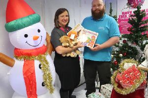 Rachel Ollerenshaw and Sam Dunn promote the Christmas toy collection for Molly Olly's Wishes taking place at Jump In trampoline park in Warwick.