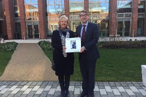 Photographer Gill Fletcher presenting the book to King's High head teacher Richard Nicholson.