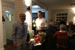 Roger Davies, the chair of the Cancer Research UK Kenilworth committee, and Sean Rouse, the chef and manager at The Anchor Inn pub