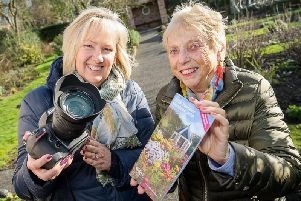 Gill Fletcher with Rosemary Mitchell who is holding a copy of the RHS Partner Gardens 2020 booklet featuring Hill Close Gardens.