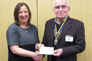 Warwick Rotary President David Brain presented Rachel Ollerenshaw with a cheque towards her work. Photo supplied.