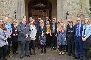 Representatives from Warwickshire Police, Coventry and Warwickshire Partnership NHS Trust and NHS England outside Leek Wootton Police HQ for the launch event.