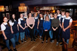 Hatton Arms manager Stephanie Ward (in blue) with the team. Photo supplied.
