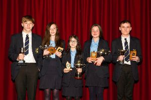 Ryan McCauley, Sophie Davidson, Silvia Dinu, Jodie McCourt and Reece McAllen receiving awards for attainment and endeavour in key stage 3.