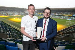 Championship Player of the Month Jeff Hughes collects his Belleek trophy from NIFWA Chair Keith Bailie