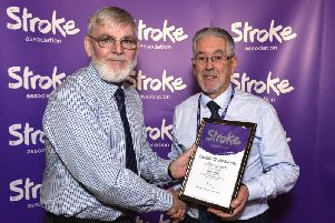 Larne Stroke survivor and volunteer George Stewart, receiving his nomination certificate from Stroke Association committee member Peter Deazley.