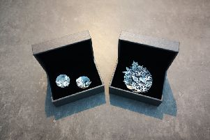 The cufflinks and brooch designed by Vera McCullough. The jewels include Alexandrite and Garnet, the birthstones of the Duke and Duchess of Cambridge.
