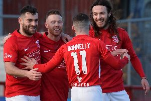 Larne striker, David McDaid celebrates Ben Tilney's goal against Ballinamallard.
