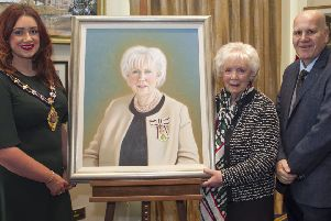 Lord Lieutenant Joan Christie CVO OBE is presented with her portrait by the Mayor of Mid and East Antrim, Cllr. Lindsay Millar and Cllr.Paul Reid.