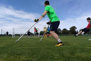 Amputee footballers practising with the new Belfast Amputee Football Club