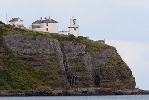 Blackhead lighthouse sits majestically on top of the cliff face   CT37-476RM