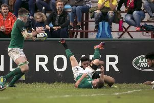 Ireland's Ryan Baird scores a try