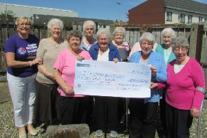 Roma Brown from the Larne Support Group receiving a cheque for �2000 for the Children's Hospice from the ladies of the Greenland Senior Citizens' Club.