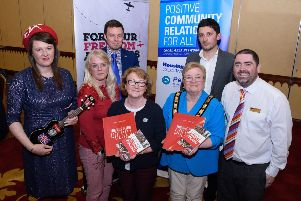 L-R: Katie Carr, musician; Vivienne Walsh, Mid & East Antrim Investment & Funding Delivery manager; Tomasz Tadla, Deputy Consul for the Republic of Poland (Belfast); Mairead Myles Davy, Area manager Housing Executive;  the Deputy Mayor, Cllr Beth Adger MBE;  Maciek Bator, 'For Your Freedom and Ours' Programme director and Stephen Gamble, Housing Executive.