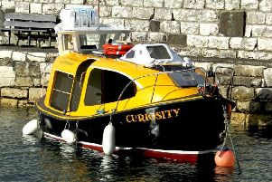 'Curiosity' moored at Carnlough Harbour.