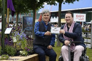 Patrick Merrick (left) is presented with a bronze award from Mark Lane at the Gardeners' World Beautiful Borders competition at the NEC in Birmingham.