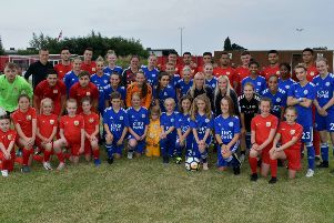 Melton Town and Leicester City Women pose for a mixed team picture before their landmark match EMN-190717-141147002