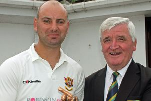 Brigade captain Andy Britton pictured receiving the Man of the Match trophy from Connie McAllister, North West Cricket Union President.