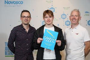 Pictured receiving his certificate for successfully completing Novosco Camp is David John Kennedy from Coleraine, a pupil at Dalriada School, with Dr Ian Cleland, left, of Ulster University and Patrick McAliskey, right, Managing Director of Novosco