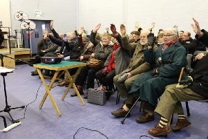 A show of hands at a public meeting in January 2015 in support of  pedestrian safety improvements and a park and ride at Ballycarry Station.
