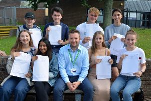 James Hamilton, head of 6th form, and students SUS-190815-114907001