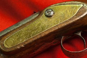 Close up detail of a musket exhibited in the Royal Irish Fusiliers Museum in Sovereign's House on The Mall in Armagh, which carries the motto 'Faugh a Ballagh' which means 'Clear the Way'. It is planned to consolidate the Armagh facility into the new Belfast project.