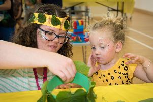 Buckingham Summer Club held at Lace Hill Community Centre - Lacey Burns (three) is helped by National Trust Stowe's Amy Bellinger to make a crown