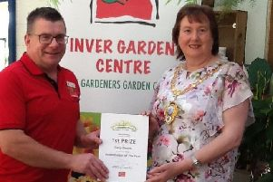 Gary Bissett is presented with the Ambassador of the Year 2019 prize by the Mayor of Mid and East Antrim, Cllr Maureen Morrow.