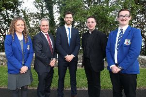 Head Girl Rachael McLaughlin, principal Jonny Brady, guest speaker Neil McManus, Fr Conor McGrath and Head Boy Anthony Murray.