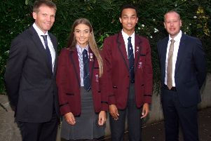 Head Girl and Head Boy, Jenna McCarlie and Matthew Clenaghan with guest of honour Simon McDowell and principal, Jonathan Wylie.