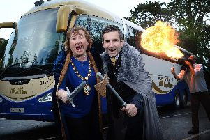 Mayor of Mid and East Antrim, Councillor Maureen Morrow, pictured with John Morgan from Translink and fire performer Logy.