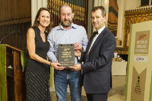 John Agnew, Ann's Pantry, Larne, is presented with his award by Claire Andrew of Andrew Ingredients at the event hosted by Stephen Hallam, Master Baker, managing director of Dickinson & Morris and chair of the judges.