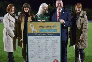 Women's Aid ABLCN Ambassador Cllr Noreen McClelland, White Ribbon co-ordinator Tahnee McCrory and chairperson Lindsay Harris present the White Ribbon Charter to Larne FC chairman, Gareth Clements, with South Antrim MLA Pam Cameron.