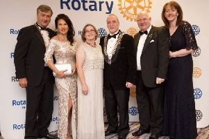 District Governor William Cross and Tedi Cross, Kate Black and Bernard Black, Lions District Governor, Padraig O'Kane, Antrim Coast Lions Club, and Mary O'Kane.
