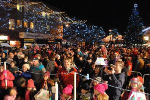 Crowds gather for the switching on of Christmas lights at Broadway in Larne (archive image).  Details of the switch on ceremonies across Mid and East Antrim have been released.
